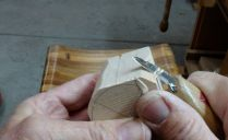 One way to carve is to hold the knife as shown...