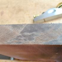 Removing saw marks with block plane on ends