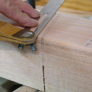 Draw lines from each side of kerf, flip board and complete cut