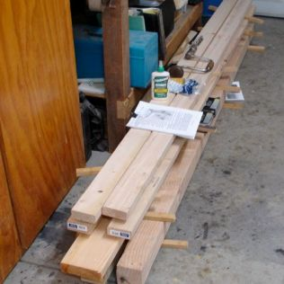 A pile of wood, glue, screws, and bolts