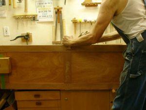 Adjusting strike edge of door