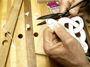 Scissors easily cut curves, rotate pattern while cutting