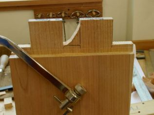 Coping saw to remove waste between twin tenons