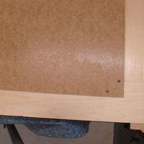 Hardboard back, screwed in place