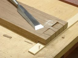 Waste chiseled out, always start with removing a small chip to clear bevel of chisel