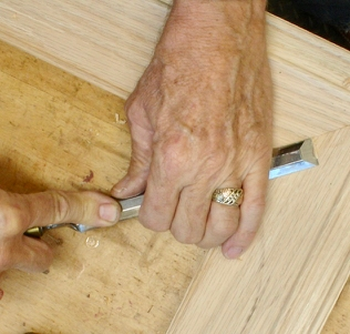 Offset paring chisel used to even out miter as needed