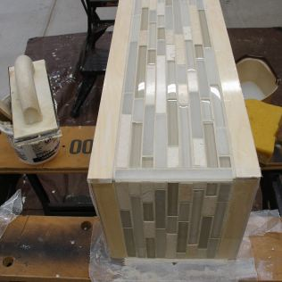 Section of tile used as end cap