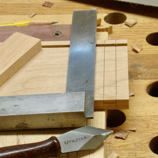 Scribe lines for dado, notch edge with chisel first to help guide saw